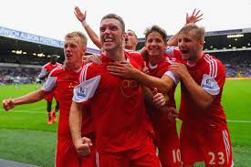 Rickie Lambert and teammates celebrate
